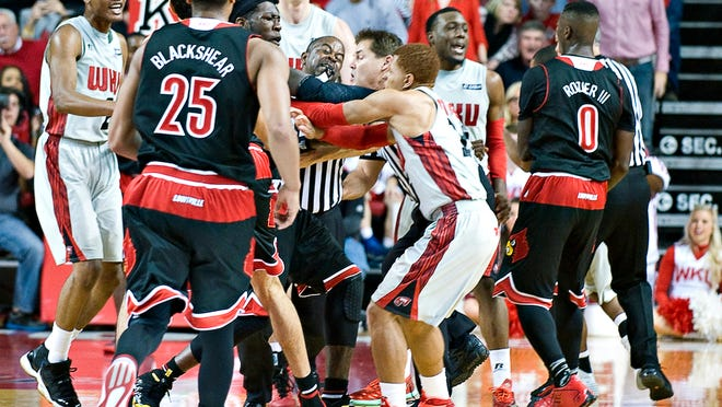 A fight broke out during an NCAA college basketball game between Louisville and Western Kentucky, Saturday, Dec. 20, 2014, in Bowling Green, Ky. (AP Photo/The Daily News, Miranda Pederson)