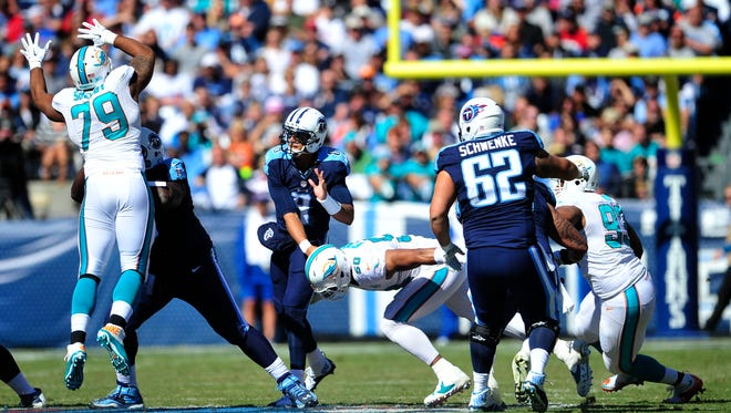 Titans quarterback Marcus Mariota is injured on a hit from Dolphins defensive end Olivier Vernon. Mariota suffered a sprained MCL.