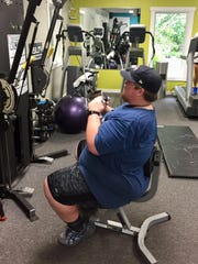 Daniel exercising the mid-back with a lat pulldown.