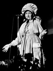 Edna Wilson, better know to Grand Ole Opry fans as Sarie of the Sarie & Sally comedy team of the 1940s, brings back the laughter she had last inspired from the stage in 1950 for the packed Municipal Auditorium crowd March 15, 1975.