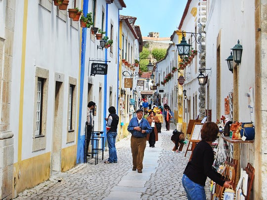 The wall in Óbidos, Portugal, provides views over the