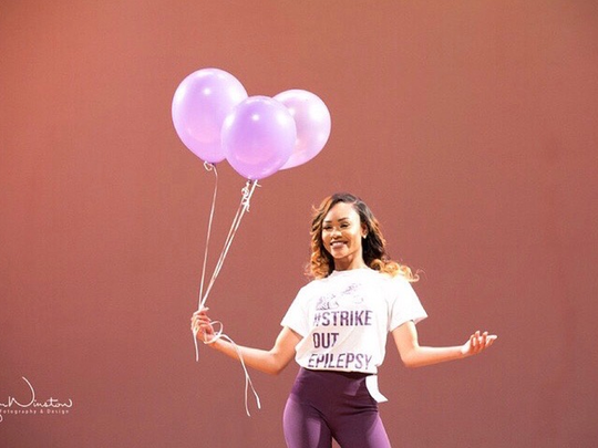 """Daisha McGowen takes a stand against epilepsy during the """"Miss Black & Gold"""" Scholarship Pageant established by the Beta Nu Chapter of Alpha Phi Alpha Fraternity Incorporated."""