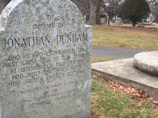 A memorial for Jonathan Singletary Dunham next to a