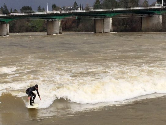 Anders Handorg, 26, of Huntington Beach, surfs waves