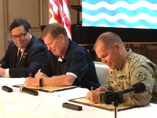 John LaRue (center), executive director of the Port