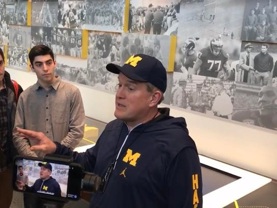 Michigan offensive line coach Ed Warinner speaks with