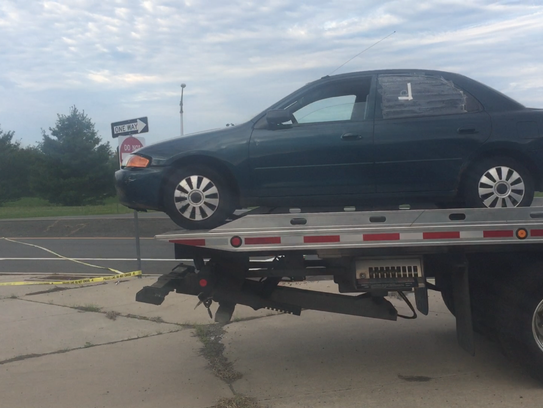 A car is towed from Rt. 33 crime scene.