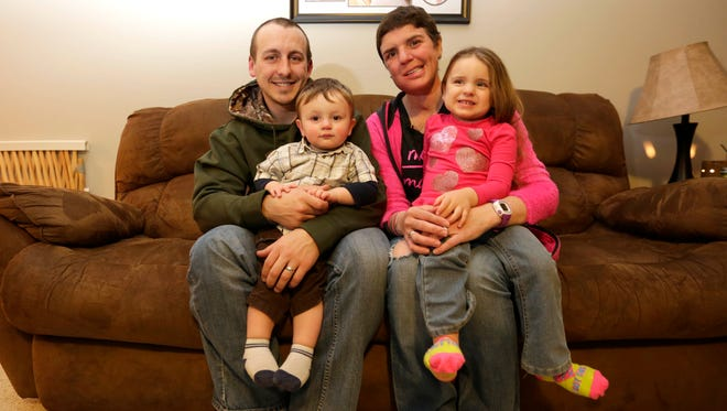 Nathan Zuelke with his wife, Lindsay, and their two children, Danica and Easton, in their living room in March 2016. Lindsay passed away in December.