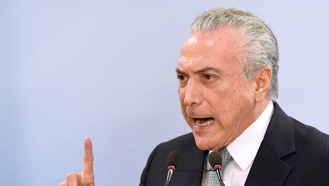 Brazil's President Michel Temer speaks during a press conference following allegations that he gave his blessing to payment of hush money to a politician convicted of corruption, on May 18, 2017 in Brasilia.