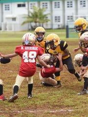 PXC Southside 49er Laython Biddle (7) makes the tackle on an Island Eagles player during their GNYFF Youth Football League game at University of Guam field in Mangilao on Sept. 13.