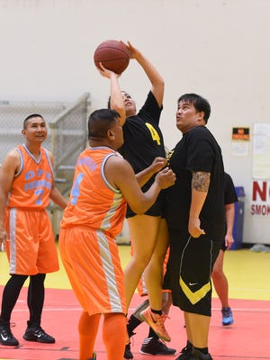 DOA player Marie Benito (4) drives to the basket against DPR Defenders during their DPR GovGuam Basketball League game at the Guam Sports Complex Gym in Dededo on Oct. 26. fsannicola@guampdn.com