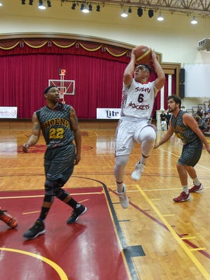 Sushi Rockets player Earvin Jose (6) takes a jump shot against the Phoenix Sons during their Guam Basketball Association championship game at the Father Duenas Memorial School Phoenix Center in Mangilao on May 7.