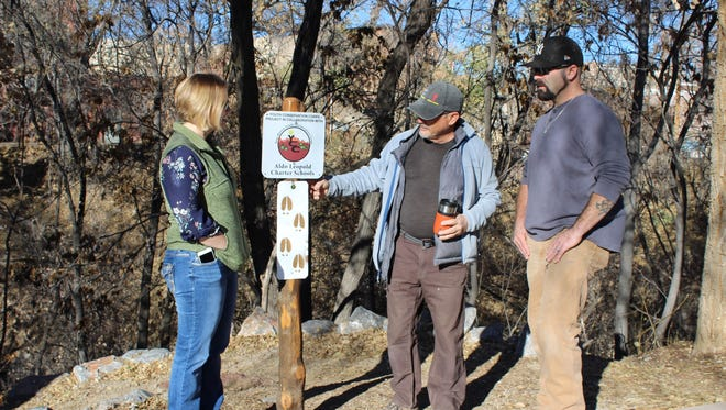 From left, Jaime Embick, Silver City Community Development Director, trail advocate Bob Schiowitz, and new trails maintenance worker Dustin Gnader take a walk along a few of Silver City's hiking trails earlier this month to discuss trail maintenance needs.