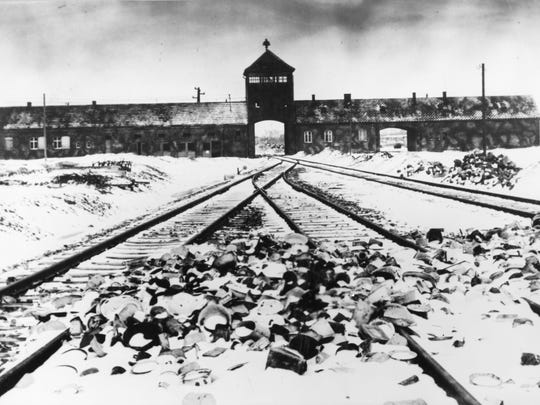 Entry to the concentration camp Auschwitz-Birkenau, Poland, with snow covered railtracks leading to the camp in February/March 1945. The Auschwitz-Birkenau camp was the largest camp where people were terminated during the fascist regime rule of dictator Adolf Hitler over Germany during WWII. (AP Photo/Stanislaw Mucha)