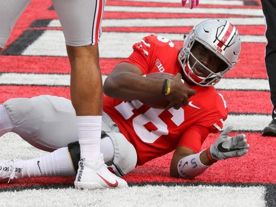 Buckeyes quarterback J.T. Barrett (16) dives for a touchdown during the first half against the Maryland Terrapins Saturday.