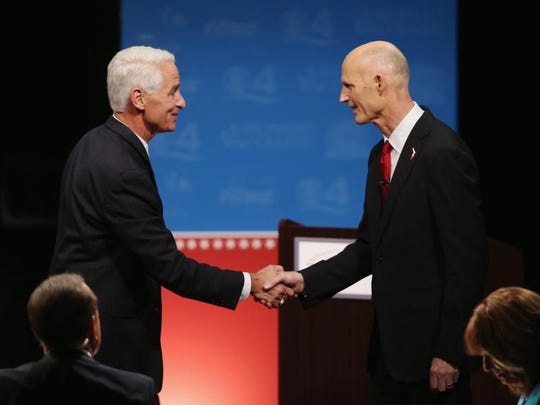 Challenger Charlie Crist and Gov. Rick Scott had a standoff over Crist's electric fan prior to the debate Wednesday night.