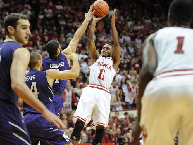 IU's Yogi Ferrell has a shot blocked by Drew Crawford in the lane during the second half of a loss to Northwestern on Saturday. The Hoosiers face Michigan State on Tuesday in East Lansing, Mich.