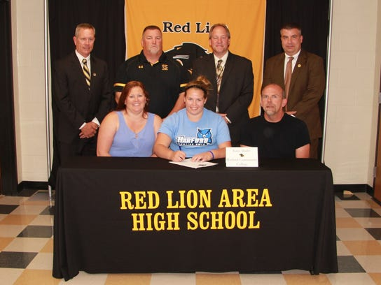 Suzette Shultz, Katie Shultz signing to play softball at Harford Community College, Michael Shultz. Back Row: Arnie Fritzius, Director of Athletics;  Terry Choate, Head Coach; Dr. Scott Deisley, Superintendent;   Mark Shue, Principal.