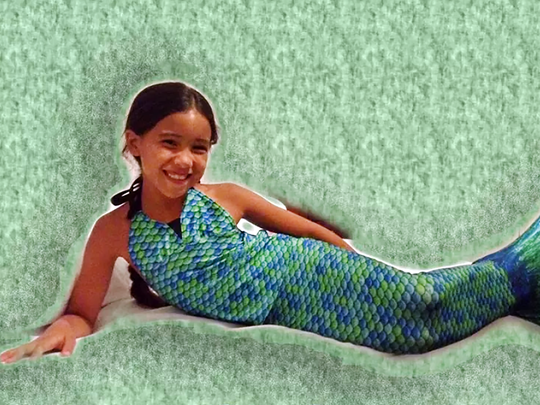 Nittaya Fisher, 7, became a mermaid after meeting Portland resident Bonnie Lavender.