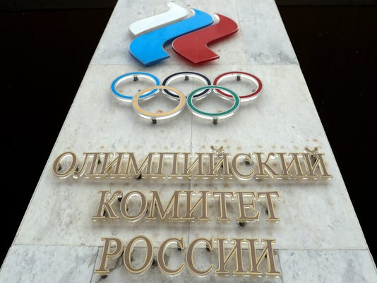 FILE - In this file photo dated Wednesday, Dec. 6, 2017, the logo of the Russian Olympic Committee at the entrance of the head office in Moscow, Russia.  The International Olympic Committee said Thursday Jan. 25, 2018, that it has obtained new evidence of steroid use in Russian sports, and will be using it to vet Russian athletes ahead of next month's Winter Olympics.  (AP Photo/Pavel Golovkin, FILE)