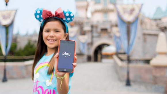 Proudly show your free Play Disney Parks app, with