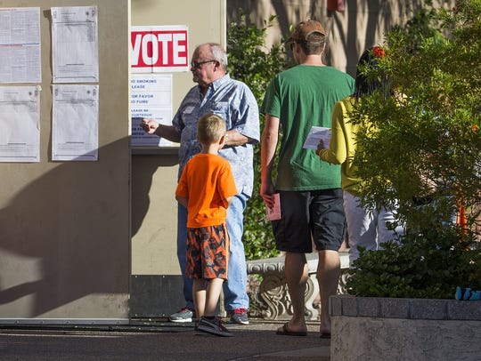 Voters enter the Mountain View Lutheran Church in Ahwatukee