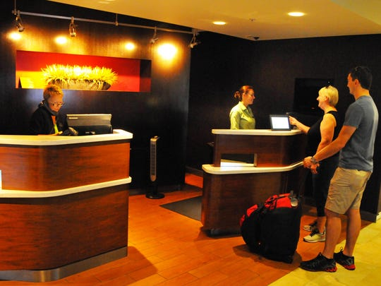 Customers visit the front desk of the Courtyard by