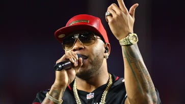 """Flo Rida's """"My House"""" the No. 1 iTunes track."""