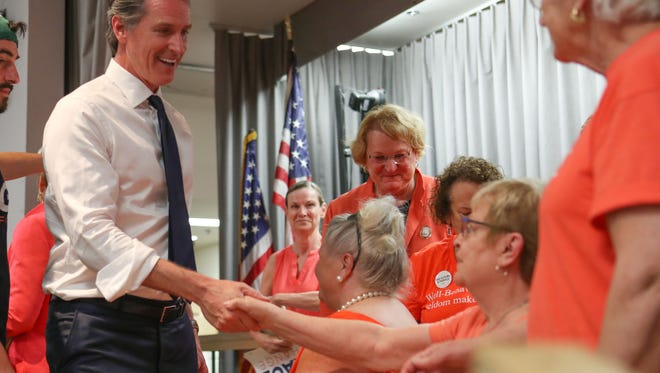 Then-Lt. Gov. Gavin Newsom greets supporters at the Mizell Senior Center in Palm Springs on May 31, 2018.
