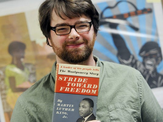 "Scott Mussell, a political memorabilia expert with Hakes Americana & Collectibles, holds a copy of ""Stride Toward Freedom,"" Martin Luther King's first book, about the Montgomery Bus Boycott. King signed the book's fly page and wrote an inscription to Chief Justice Earl Warren, who led the Brown v. Board of Education ruling, ending segregation in public schools."