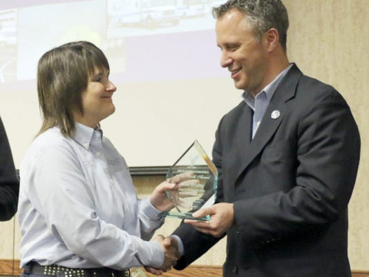 Steve Libhart, chairman of the South Central Task Force, presents Janet Bradley of First Aid and Safety Patrol, Lebanon, with a Mrs. Smith Award. The award is given to emergency responders who have gone above and beyond for the regional effort of better disaster preparedness.