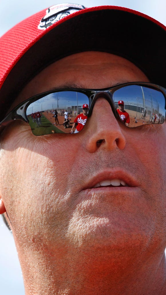 Reds manager Bryan Price looks on during spring training