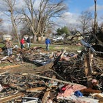 Debris litters the backyards of the homes in Kokomo following tornadoes in mid-November.
