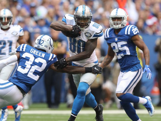 Lions WR Anquan Boldin runs after a catch against the