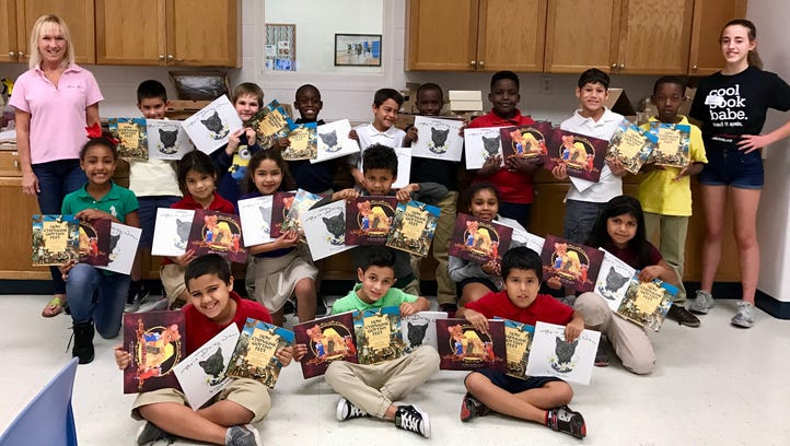 Second-grade children enjoy their book selections thanks