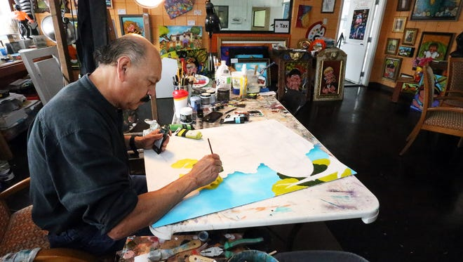Francisco Romero work in his studio at 109 Argonaut in West El Paso. The artist, known for his figures with big round faces, will be part of the 2016 Artists Studio Tour.