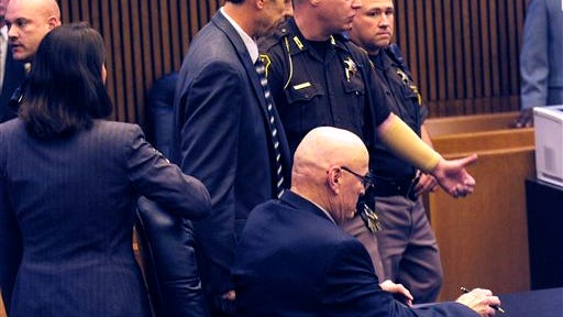 Theodore Wafer, left, is lead out of the courtroom after being found guilty of of second-degree murder and manslaughter Thursday, Aug. 7, 2014 in Detroit. Wafer, 55, shot Renisha McBride through a screen door on Nov. 2, hours after she crashed into a parked car a half-mile from his house. The jury convicted Wafer of second-degree murder and manslaughter after deliberating for about eight hours over two days.  (AP Photo/The Detroit News, Clarence Tabb Jr.)