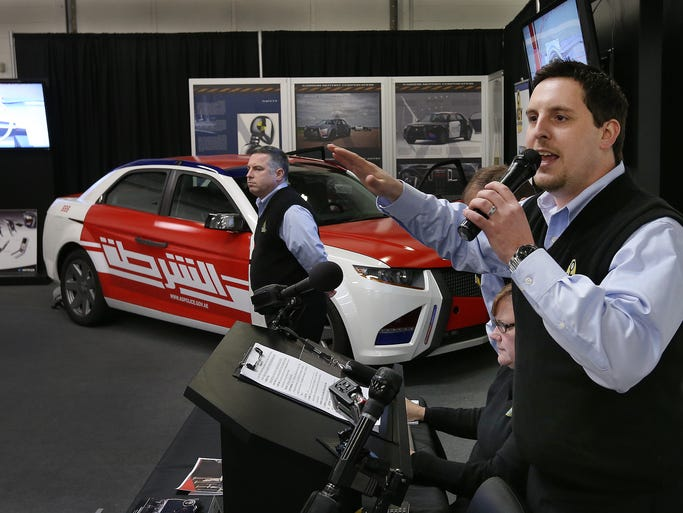 Ted Pike of Key Auctioneers runs the bidding as they auction off the Carbon Motors E7 Super Cop Car Thursday afternoon at the Key Auctioneer office on South Harding Street. The car sold for $74,000 to an online bidder from Wisconsin.