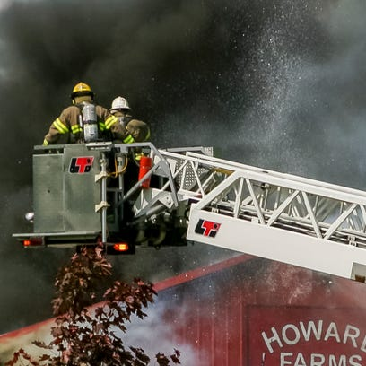 Dryden firefighters maneuver their aerial truck into