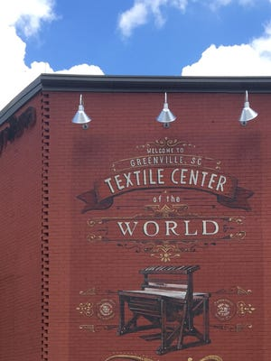 An vintage advertisement covers the side of a building in Greenville, South Carolina.