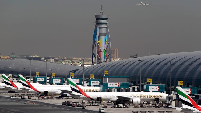 This file photo from May 8, 2014, shows passenger planes at the Dubai International Airport.