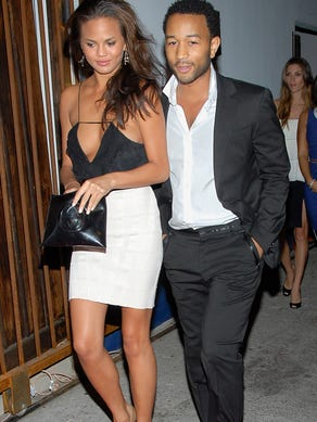 Singer John Legend, right, and his girlfriend, model