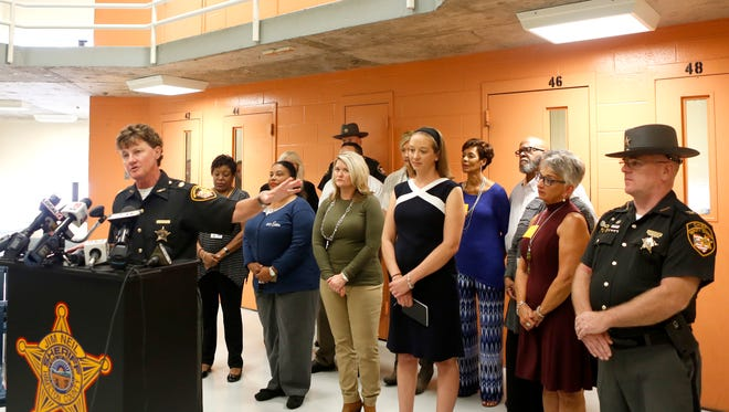 Major Charmaine McGuffey speaks to the press Monday about the Hamilton County Justice Center's heroin recovery pod pilot program while flanked by representatives from social service agencies that have volunteered to help the initiative.