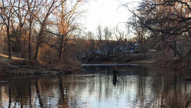 A man fishes in the South River in Waynesboro, Va., on Monday, Feb. 13, 2017.