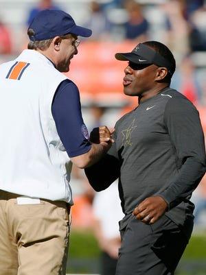 Auburn head coach Gus Mazlahn talks with Vanderbilt Commodores head coach Derek Mason before the game at Jordan Hare Stadium on Nov. 5, 2016.