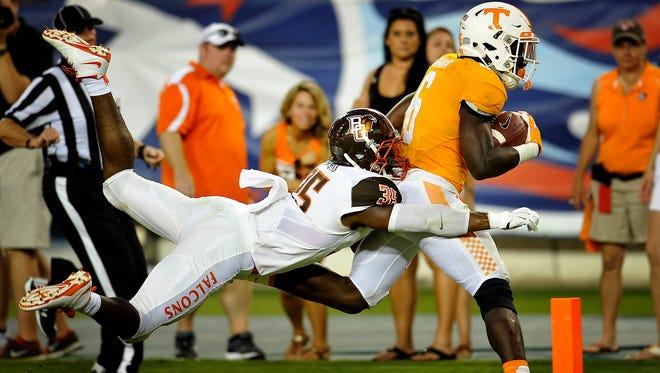 Tennessee running back Alvin Kamara (6) carries Bowling Green linebacker James Sanford (35) with him as he crosses the goal line for a touchdown on Sept. 5, 2015 at Nissan Stadium.