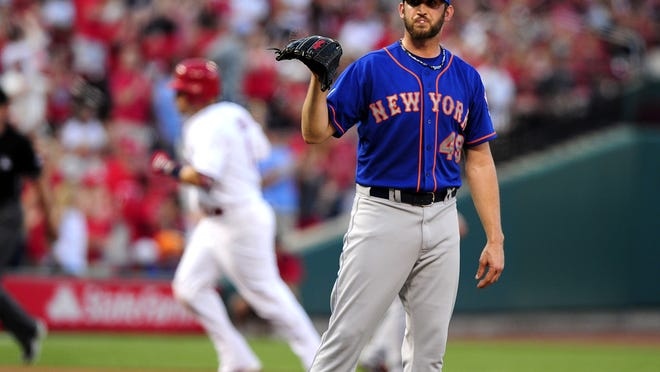 Mets pitcher Jon Niese waits for a new ball after giving up a home run to Yadier Molina on Tuesday night.
