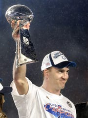 Colts quarterback and MVP Peyton Manning hoists the