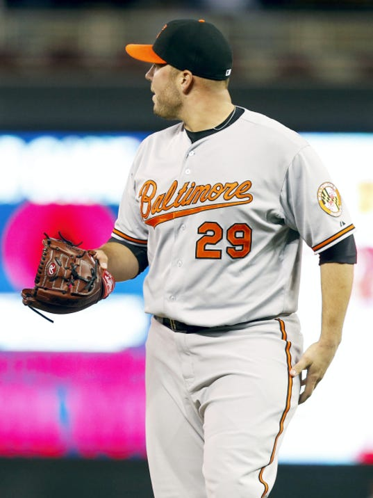Baltimore relief pitcher Tommy Hunter looks to the outfield as Minnesota's Brian Dozier hits a two-run, walk-off home run in the 10th inning on Monday. The Twins won 4-2.