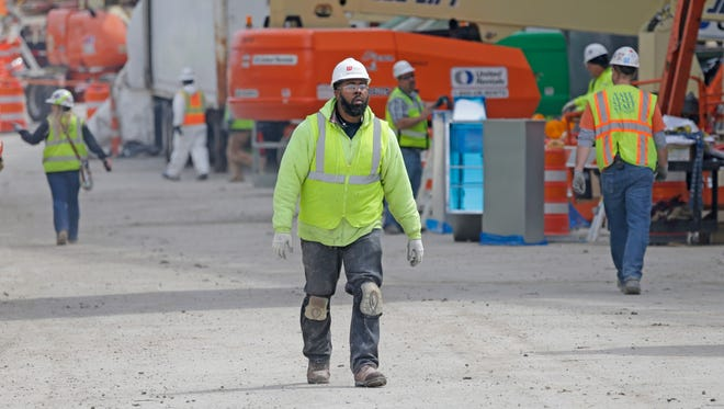 Workers are seen near the site of the new Milwaukee Bucks arena in downtown Milwaukee.